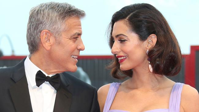 George and Amal Clooney pose for photographers during at the Venice Film Festival in Venice, Italy. Picture: Joel Ryan/Invision/AP