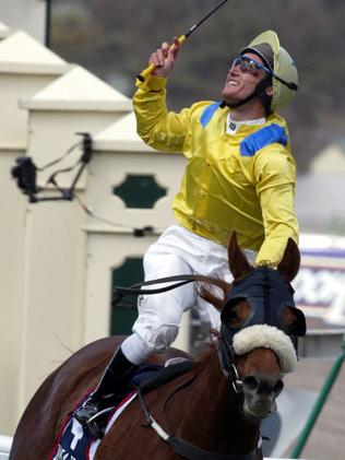 An emotional Damien Oliver celebrates his win on Media Puzzle in 2002.