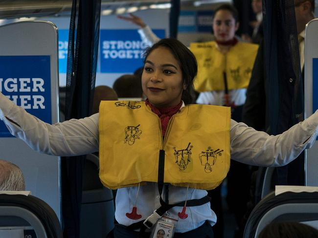 Image result for FLIGHT STEWARDESS DEMONSTRATING BEFORE TAKE OFF PIC
