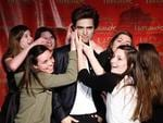 <p>Girls pose next to a wax figure of Robert Pattinson at the Madame Tussauds unveiling in New York, on Thursday, March 25, 2010. AP</p>