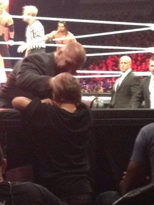 Triple H breaks character to console the boy. Picture: @chrisolds2009