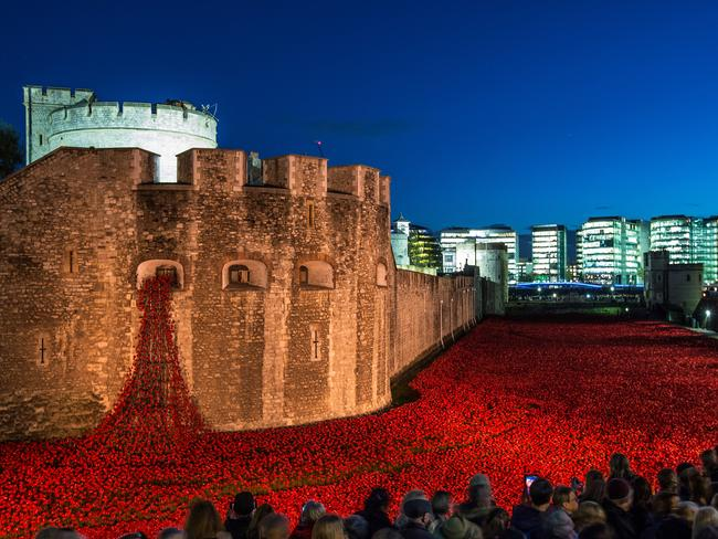 Visitors view the 'Blood Swept Lands and Seas of Red' installation at the Tower of London. The poppies represent each of the commonwealth servicemen and women killed in World War I. Picture: Dan Kitwood/Getty Images