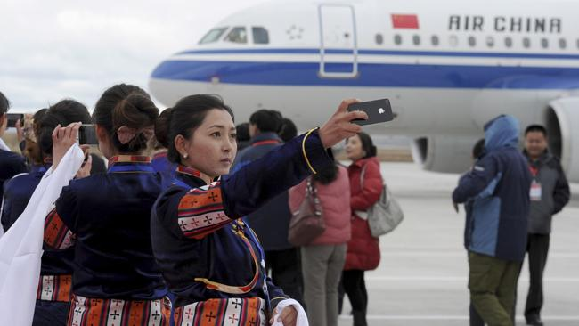 The first planes touch down at the world's highest altitude airport. Picture: AP