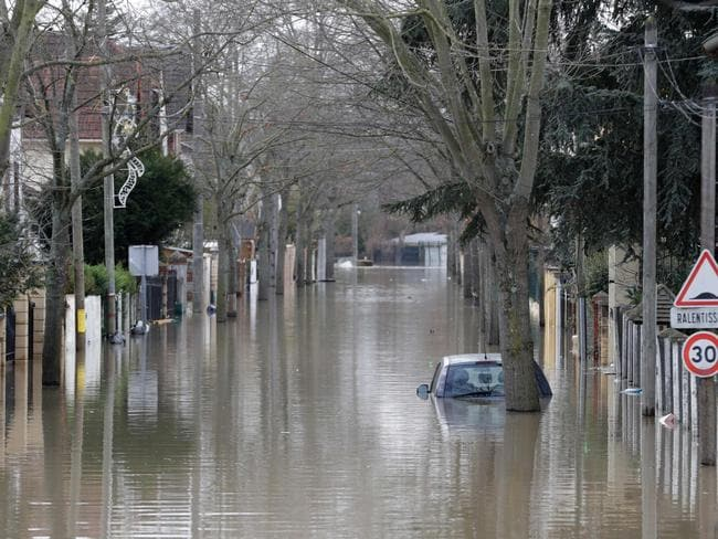 The rapidly rising floodwaters caught some off guard. Picture: AFP