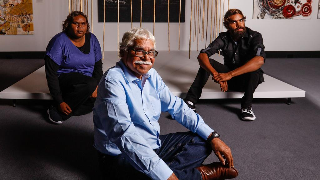 <s1>  National Aboriginal and Torres Strait Islander Art Award winners Unrupa Rhonda Dick, Frank Young and Anwar Young </s1>with their work  <i>Many Spears — Young Fellas Story</i>.  <source></source>Picture: GLENN CAMPBELL  <source></source>