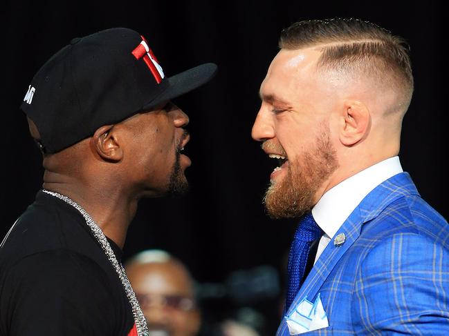 TORONTO, ON - JULY 12:  Floyd Mayweather Jr. and Conor McGregor faceoff during the Floyd Mayweather Jr. v Conor McGregor World Press Tour at Budweiser Stage on July 12, 2017 in Toronto, Canada.  (Photo by Vaughn Ridley/Getty Images) *** BESTPIX ***