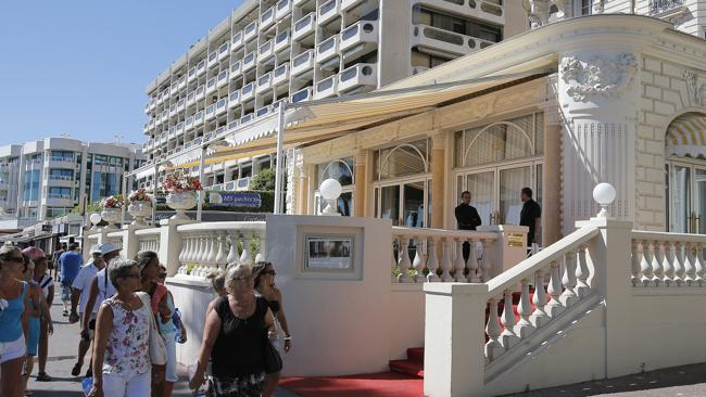 The Carlton Hotel in Cannes, scene of a daring daylight raid last Sunday, July 28. (AP Photo/Lionel Cironneau)