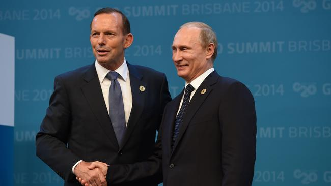 Warm welcome ... Prime Minister Tony Abbott and Russia's President Vladimir Putin exchange handshakes during the G20 Summit. Picture: AFP PHOTO