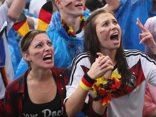 Germany fans react to play while watching the Germany-USA World Cup match.