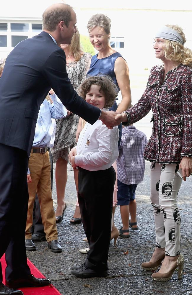 Familiar face ... Prince William, Duke of Cambridge, meets a local wearing pants with the