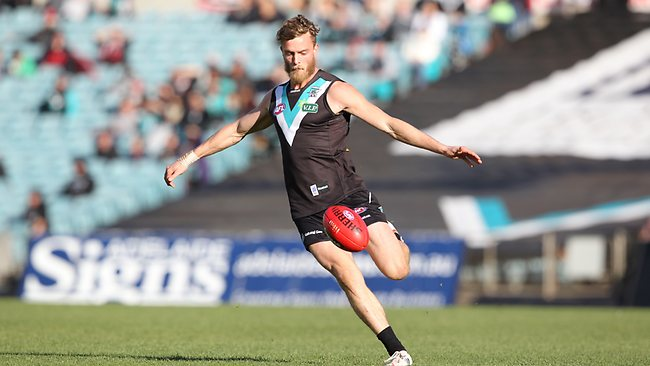 Port Adelaide footballer John McCarthy in full flight.