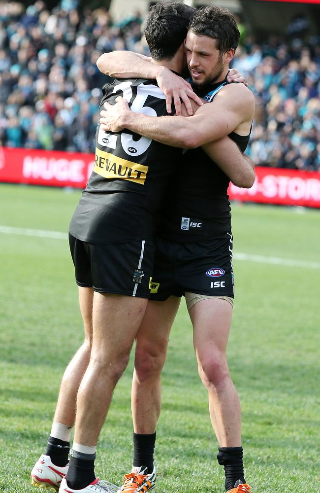 Former captain Dom Cassisi hugged by current captain Travis Boak at the end of the game. Photo Sarah Reed.