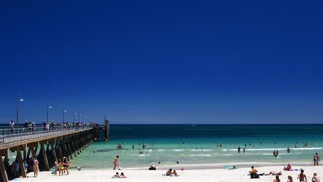 Beachgoers cool off from the heat during a heatwave at Glenelg beach, Adelaide. Picture: Daniel Kalisz/Getty Images.