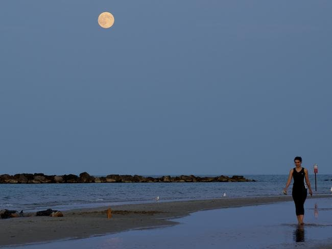 The super moon, raises over the shoreline in Roseto degli Abruzzi, Italy. AP Photo/Domenico Stinellis