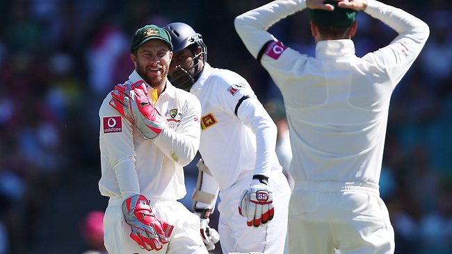 Matthew Wade rubs his shoulder after being hit while dropping a chance off Nathan Lyon's bowling. Picture: Phil Hillyard