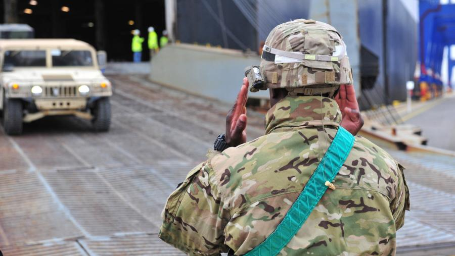 Sgt. Koffi Assila, a cargo specialist from the 1st Inland Cargo Transfer Company, directs vehicles off a cargo ship in Gdansk, Poland, earlier this year. Picture: US Army