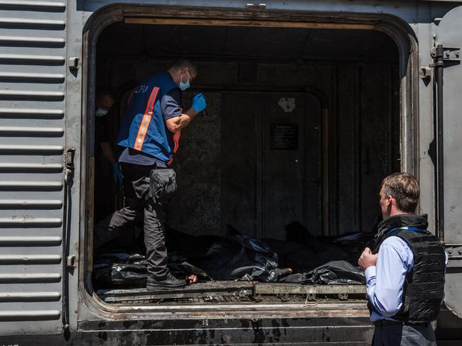 Alexander Hug (R), Deputy Chief Monitor of the Organisation for Security and Cooperation in Europe (OSCE) Special Monitoring Mission to Ukraine, visit a train containing the bodies of victims of the Malaysia Airlines flight MH17 crash on July 21, 2014 in Torez, Ukraine. Together with Dutch inspectors, the storage conditions were declared acceptable, though it is still unclear where or when the train will be moved. Picture: Getty