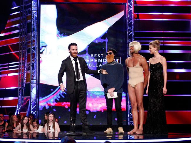 Chet Faker gets awkward on stage with Matt and Alex from Triple J.