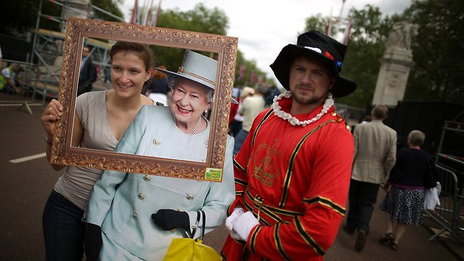 A tourist has her photograph taken with a cardboard cut out of Queen Elizabeth II in The Mall on June 1, 2012 in London, England.(Photo by Peter Macdiarmid/Getty Images)