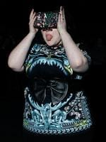 PARIS FASHION WEEK 2014: Singer Beth Ditto pokes her tongue out as she arrives for Givenchy's show. Picture: AP