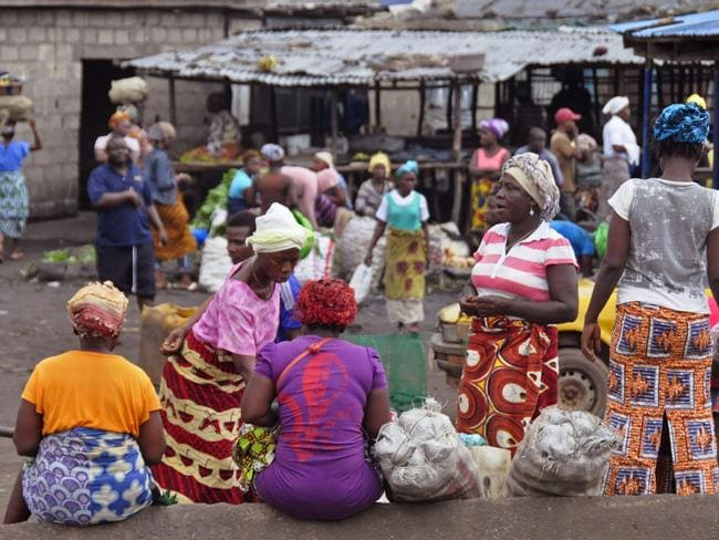 Hard hit ... women at a local market in Monrovia, Liberia, where food assistance may soon be required as measures to slow Ebola's spread have caused price hikes and slowed distribution. Picture: Abbas Dulleh