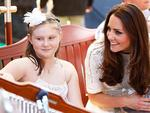The Duchess of Cambridge speaks with patients at Bear Cottage