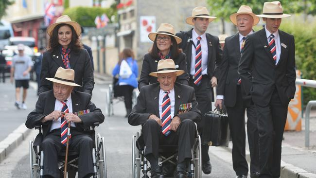 D-day heroes ... Australian veterans arrive Bayeaux for The 70th anniversary of the D-Day landings. Photo: Jake Nowakowski