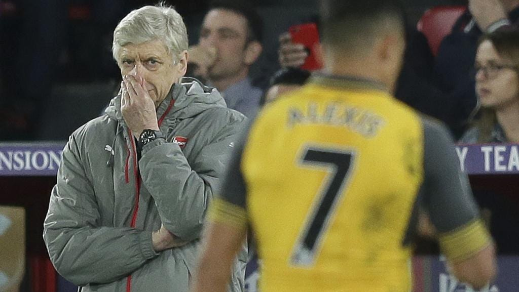 Arsenal manager Arsene Wenger looks across the pitch during a loss at Crystal Palace.
