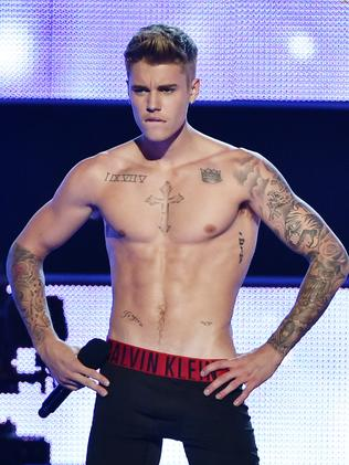 Singer-songwriter Justin Bieber shows of his tattoos in 2014. Picture: Theo Wargo/Getty Images for Three Lions Entertainment