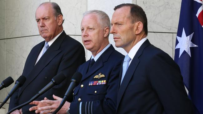 'IS has declared war' ... Tony Abbott announces RAAF combat missions in Iraq, with Defence Minister David Johnston and CDF Air Chief Marshal Mark Binskin today.