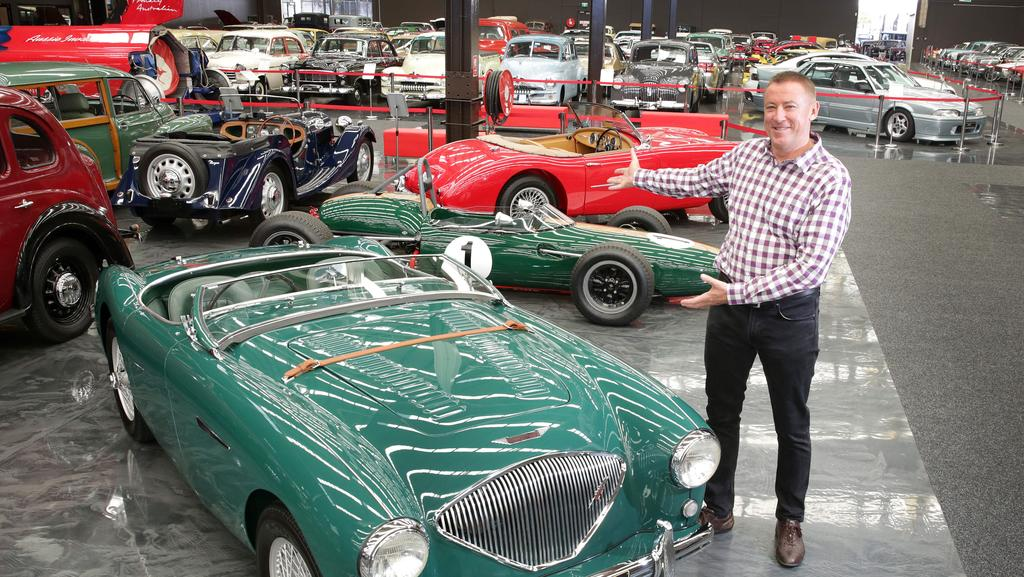 Owner Tony Denny with some of the world's finest cars at the Gosford Classic Car Museum. Picture: Mark Scott