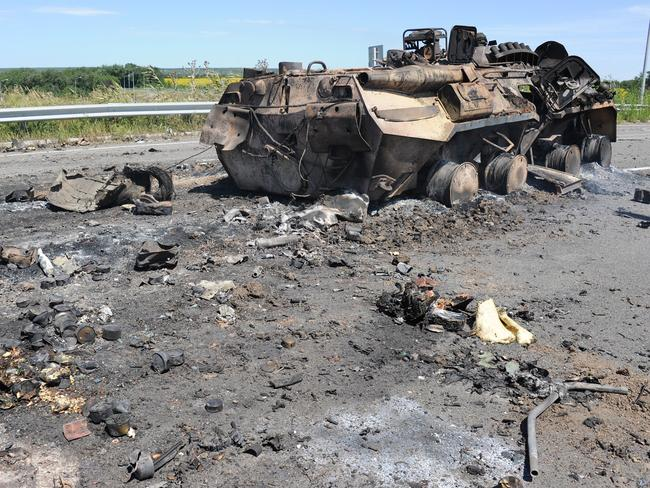 Ukrainian attack? ... a destroyed armoured vehicle on the road of the airport in the south of Lugansk.