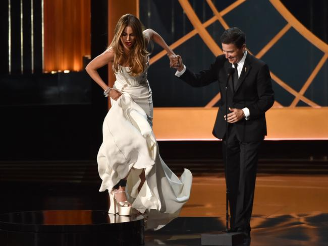 Actress Sofia Vergara is helped onto the stage by Television Academy CEO Bruce Rosenblum.