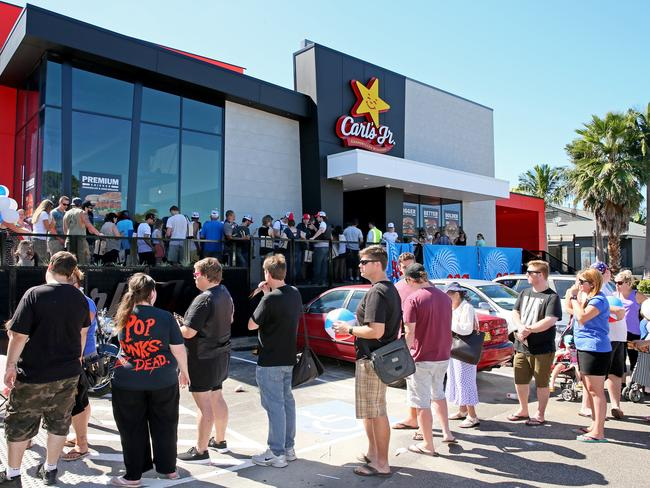 Customers queue at the opening day of business for the first Carl's Jr to launch in Australia, at Bateau Bay on the NSW Central Coast. Picture: Troy Snook