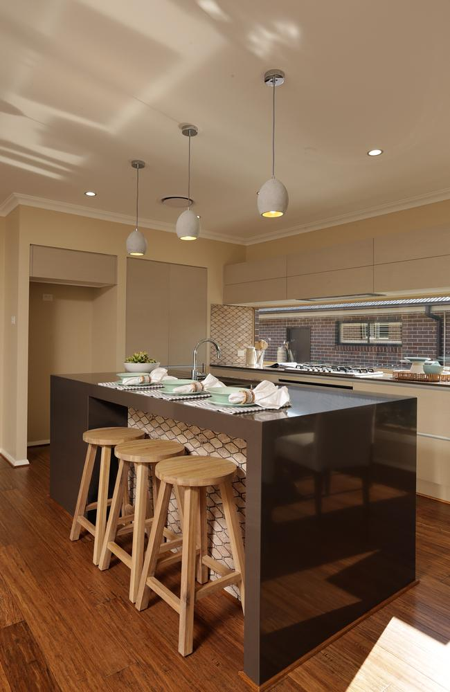 The kitchen is the central feature with the rumpus room and study areas within view. Picture: John Fotiadis