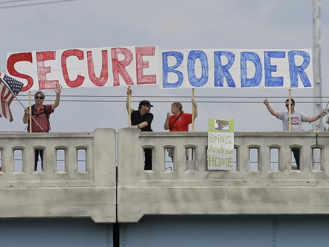 Feeling is mutual ... demonstrators with signs on an overpass in Indianapolis, to protest against people who immigrate illegally. Picture: Darron Cummings