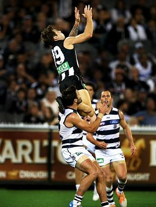 This is how you do it, Trav ... Jamie Elliott takes a hanger over Jimmy Bartel against the Cats. Picture: Wayne Ludbey