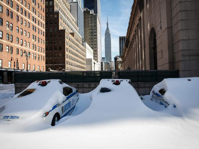 NYPD cars buried in snow. Picture: Kena Betancur