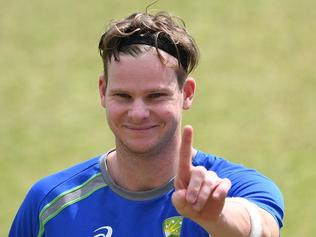Australia's captain Steve Smith gestures during a training session on the eve of fourth and last cricket Test match between India and Australia at The Himachal Pradesh Cricket Association Stadium in Dharamsala on March 24, 2017. ----IMAGE RESTRICTED TO EDITORIAL USE - STRICTLY NO COMMERCIAL USE----- / GETTYOUT---- / AFP PHOTO / PRAKASH SINGH / ----IMAGE RESTRICTED TO EDITORIAL USE - STRICTLY NO COMMERCIAL USE----- / GETTYOUT