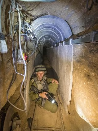 An Israeli army officer gives journalists a tour of a tunnel allegedly used by Palestinian militants for cross-border attacks. Picture: Jack Guez