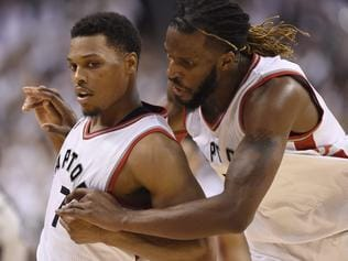 Toronto Raptors' DeMarre Carroll celebrates with teammate Kyle Lowry (7) after Lowry made a key basket late in the game during NBA playoff basketball action against the Miami Heat in Toronto on Thursday, May 5, 2016. (Frank Gunn/The Canadian Press via AP)