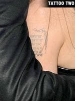 <p>Angelina Jolie shows off her new tattoos. They are swirls, that have been drawn around her existing tattoos on her left arm.</p>