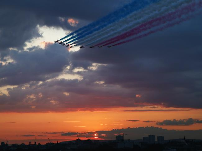 The RAF Red Arrows fly over Glasgow.