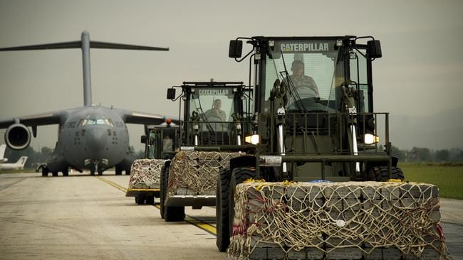 Loaded up...crates of military stores are loaded onto a Royal Australian Air Force C-17 Globemaster at Tirana Airport, Albania. Picture: Supplied.