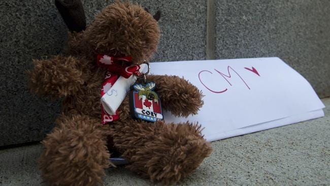 A stuffed moose and a note are left at a memorial for Canadian actor Cory Monteith outside the Fairmont Pacific Rim Hotel where he died in Vancouver. (AP Photo/The Canadian Press, Darryl Dyck)