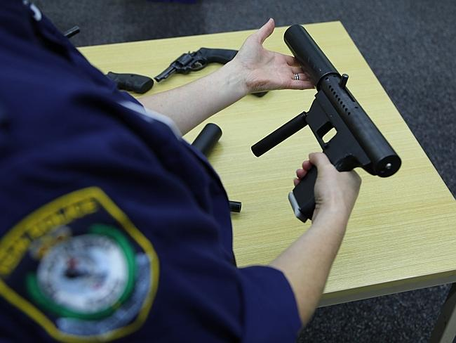 An officer displays another high-powered weapon.