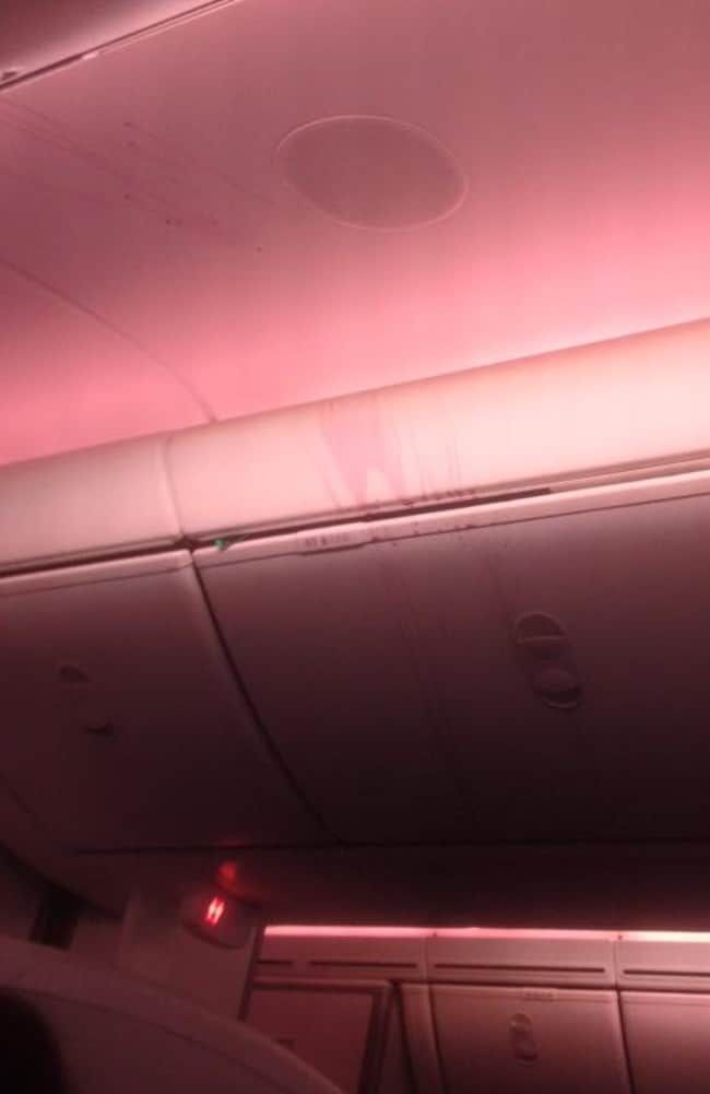 A passenger posted this pic online of the plane's red wine splattered ceiling. Picture: ollieislame/Reddit
