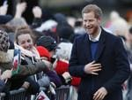 Britain's Prince Harry laughs as he meets fans as he arrives with his fiancee Meghan Markle for a visit to Cardiff Castle in Cardiff, Wales, Thursday, Jan.18, 2018. Picture: AP
