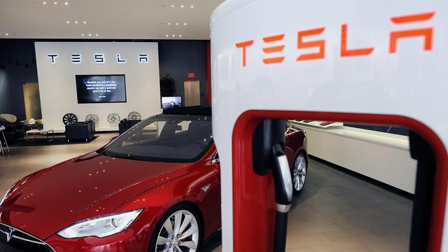 Tesla To Charge Electric Car Customers For Power