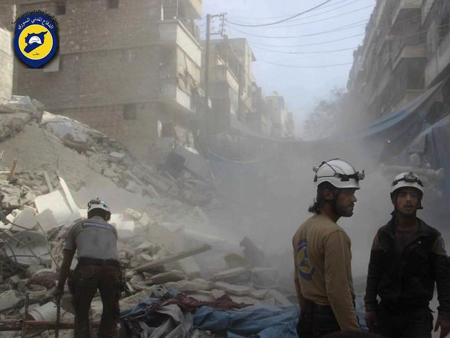 Workers from the Syrian Civil Defence group, known as the White Helmets, search through the rubble in rebel-held eastern Aleppo. Picture: Syrian Civil Defence — White Helmets via AP